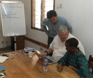 John Allen with healthcare leaders in Tanzania working on executive transition